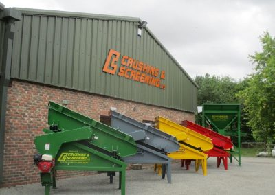 Row of finished Compact screens and Bagging Hopper outside Crushing and Screening Ltd works.